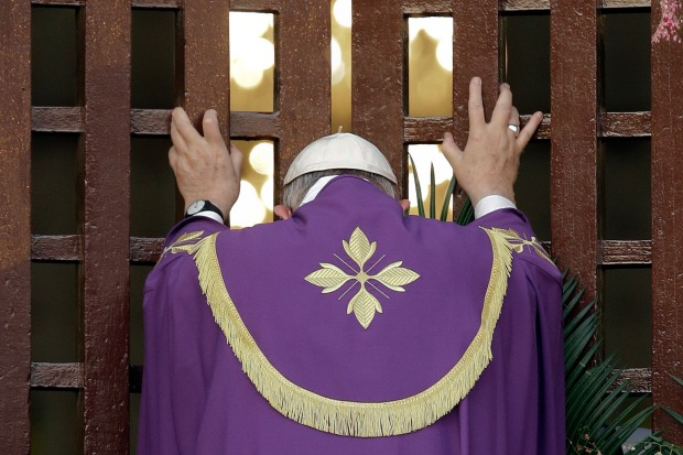 Pope Francis opens the holy door of the Bangui cathedral, Central African Republic, Sunday, Nov. 29, 2015. Pope Francis is in Africa for a six-day visit that is taking him to Kenya, Uganda and the Central African Republic. (AP Photo/Andrew Medichini)