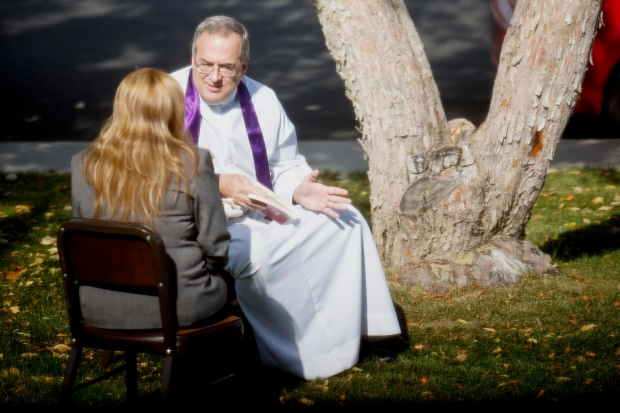 A priest hears confession on the grounds of St. Patrick's Church before a Year of Faith Mass in Casper, Wyo., Oct. 13. The special year, declared by Pope Benedict XVI, is a worldwide program of worship, catechesis and evangelization. It opened Oct. 11 and runs to Nov. 24, 2013. (CNS photo/Tim Kupsick) (Oct. 15, 2012)